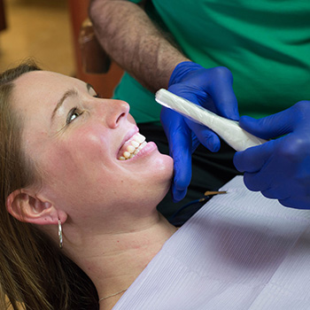 woman getting teeth cleaned at albright dental